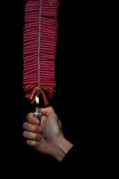 Firecrackers_lit_by_hand